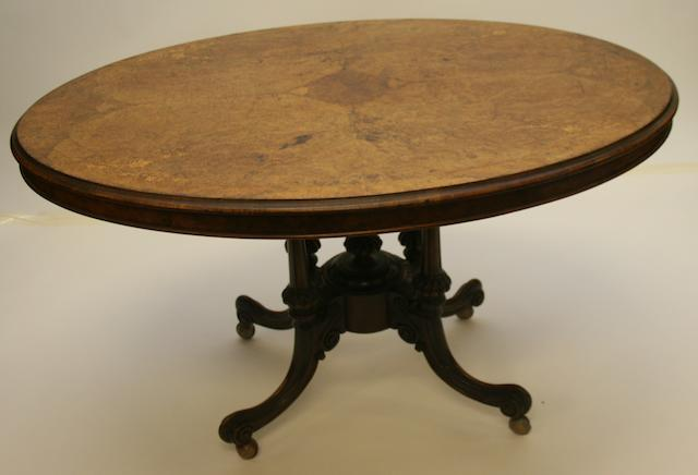 A late Victorian walnut and inlaid tilt-top loo table