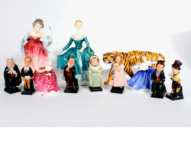 Four Royal Doulton figures of ladies, a Beswick standing Tiger, and seven Royal Doulton 'Dickens' figures