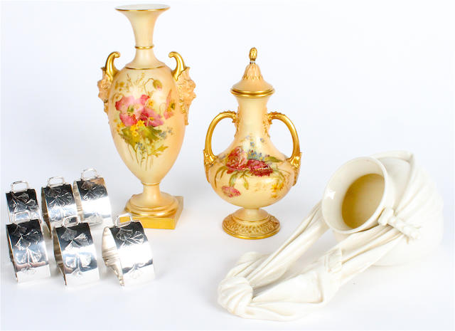 Two Royal Worcester blush ivory twin handled vases; a Royal Worcester wall pocket; and a cased set of six electroplated napkin rings.