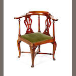 A George III 'red walnut'   corner elbow chair