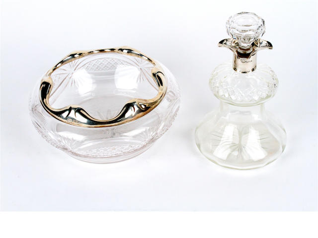 A silver mounted thistle form cut glass decanter and stopper and similar bowl