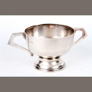 An Edwardian silver twin handled pedestal bowl By Jay, Richard Attenborough Co. Ltd, Chester, 1909,