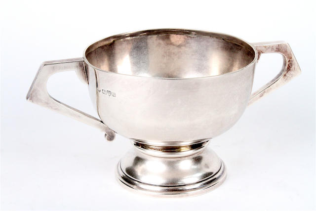 An Edwardian silver twin handled pedestal bowl By Jay, Richard Attenborough Co. Ltd, Chester, 1909,