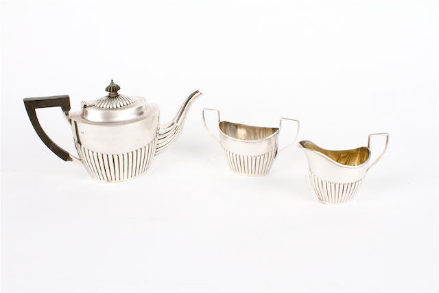 A late Victorian silver batchelor's three piece teaset By Barker Brothers, Birmingham, 1897,  (3)