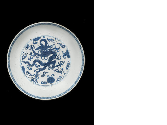 A blue and white dragon charger Jiajing