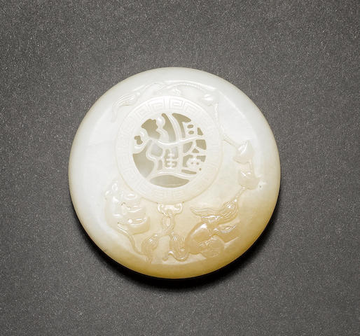 A small jade box and cover of circular form