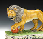 "Staffordshire figures of a tiger and a lion, titled ""The Death of a Negro"" and ""The Roaming Lion"""