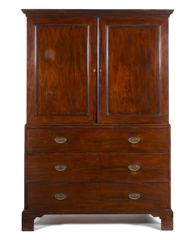 A George III mahogany secretaire linen presspossibly attributable to Thomas Chippendale