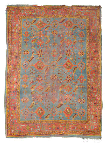 An Ushak carpet, West Anatolia, circa 1890, 12 ft 5 in x 9ft 2 in (379 x 280 cm) some wear, losses at each end