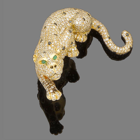 A diamond and emerald leopard brooch