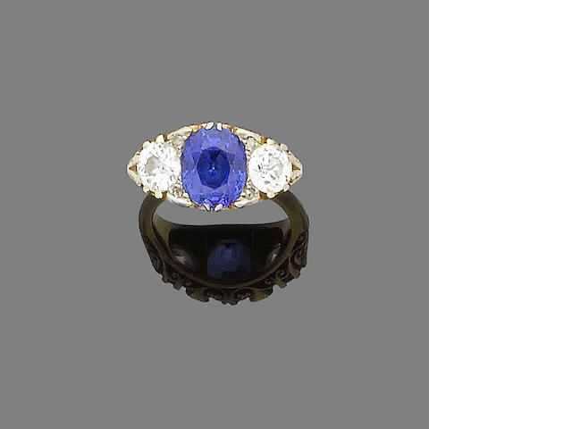 A late 19th century sapphire and diamond three-stone ring