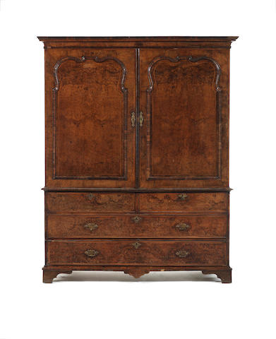 A George I walnut, burr walnut and featherbanded wardrobe