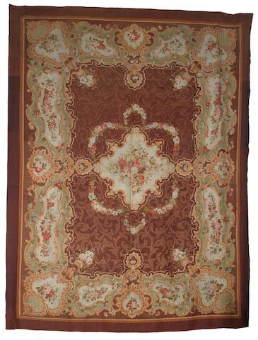A large Aubusson carpet, France, circa 1880 21 ft 7 in  x 17 ft (650 x 518 cm)