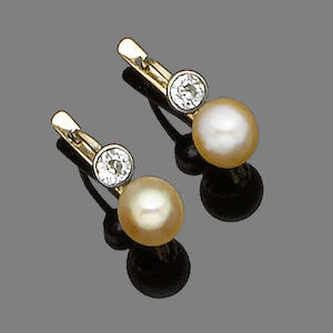 A pair of pearl and diamond earrings,