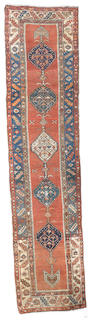 A North West Persian runner, circa 1900, 13 ft 8 in x 3 ft 3 in (415 x 99 cm) some minor wear