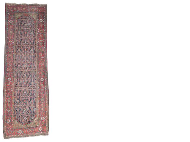 A Feraghan khelleh, West Persia, circa 1890, 17 ft 4 in x 5 ft 7 in (528 x 170 cm) minor wear, rebound selvedges, losses at each end