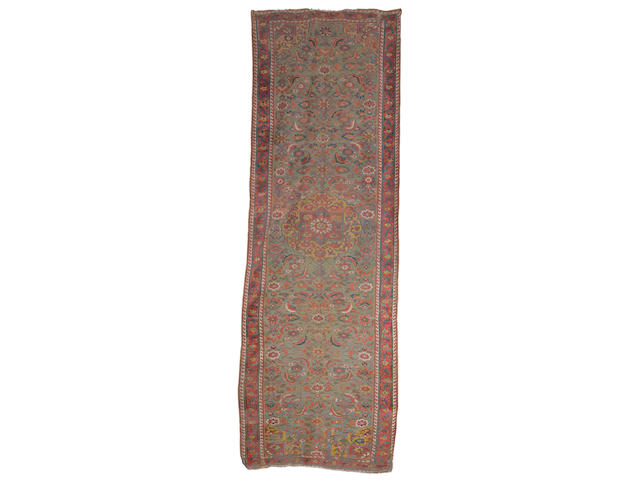 An early 19th century North West Persian gallery carpet, circa 1800, 18 ft 7 in x 6 ft 3 in (566 x 192 cm) some old restoration and minor wear
