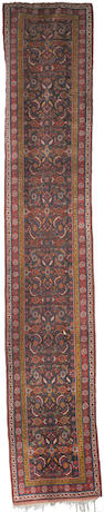 A pair of Kurdish runners, West Persia, circa 1890, each approx. 16 ft 9 in x 3ft (501 x 92 cm) some corrosion in main field