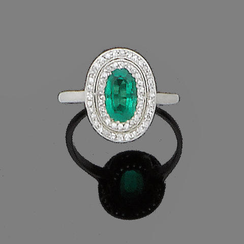 An early 20th century emerald and diamond cluster ring, by Tiffany & Co.