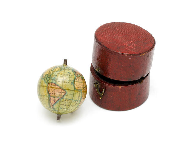 A rare miniature 1 1/8-inch Newton terrestrial globe in case,  English,  mid 19th century,
