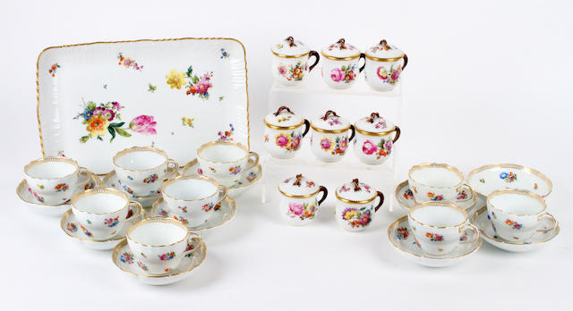A set of eight Royal Copenhagen porcelain chocolate cups and covers; a matching tray; and a set of nine Meissen cups and tea saucers Late 19th/early 20th century