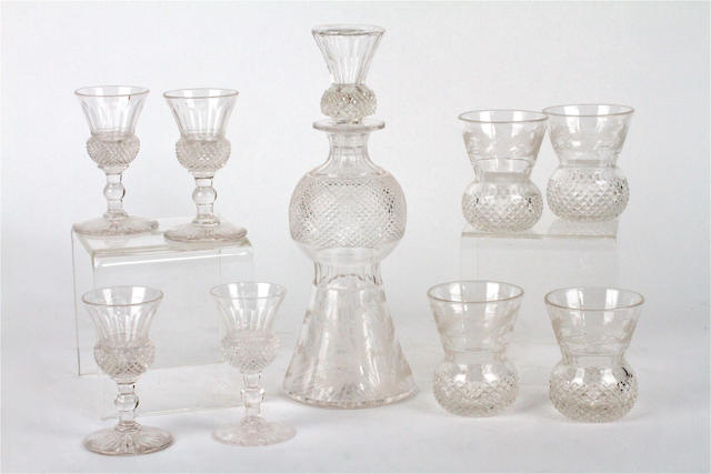 An engraved and cut glass thistle form decanter and stopper and two sets of four similar glasses Victorian and later