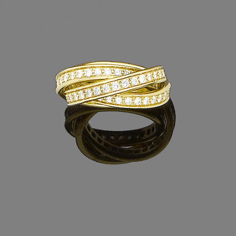 A gold and diamond trinity ring, by Cartier