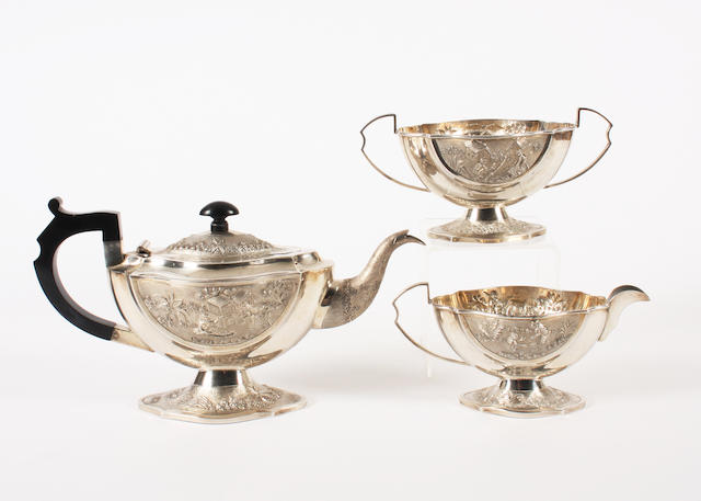 An  Indian  white metal three piece tea set Stamped 'Sterling Silver',  (qty)