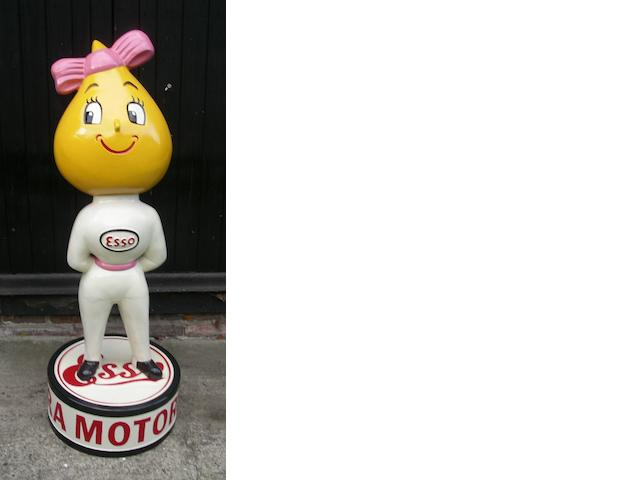 A hand-painted Miss Drip standing forecourt figure