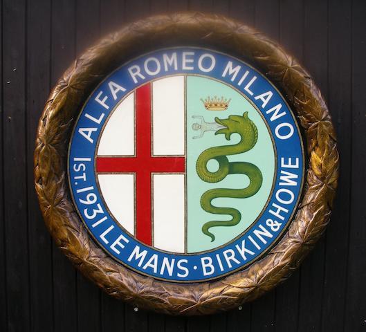 A hand-painted Alfa Romeo celebratory roundel,