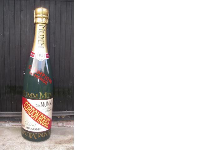 A hand-painted fibreglass celebratory half-Champagne bottle,