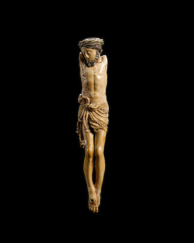 An 18th century Spanish carved and painted ivory Corpus Christi