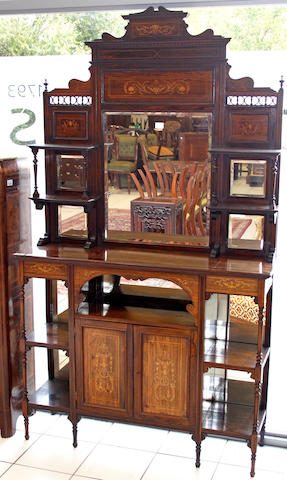 An Edwardian inlaid rosewood display cabinet,with mirrored panel back on turned feet, 122cm wide