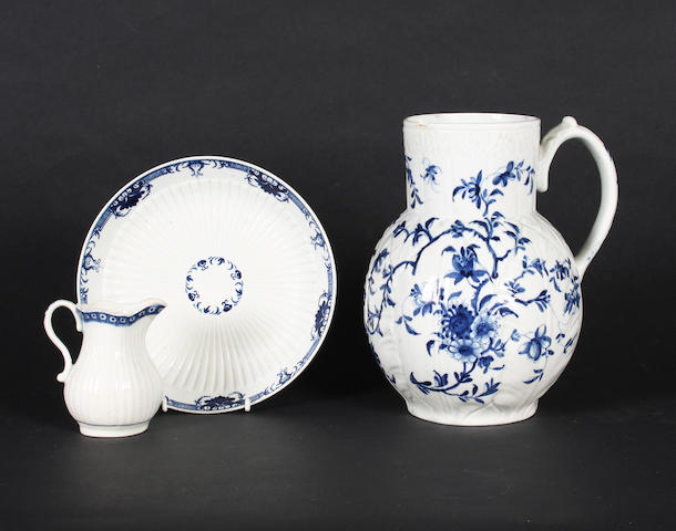 A Worcester cabbage leaf jug, a reeded cream jug and a reeded saucer dish, circa 1760-70