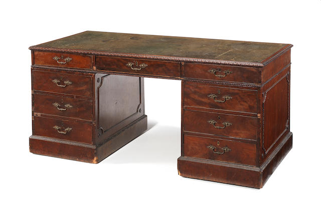 A George III mahogany pedestal partner's deskin the manner of Thomas Chippendale