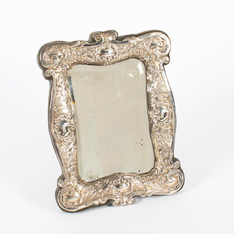 An Edwardian  silver-mounted  table mirror No maker's mark, Birmingham, 1906,