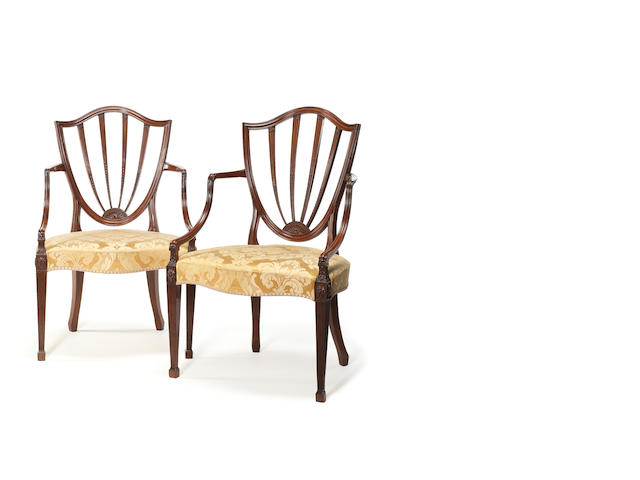 A pair of George III carved mahogany open armchairs attributed to Gillows, in the Hepplewhite taste