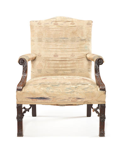 An early George III carved mahogany 'Gainsborough type' open armchair