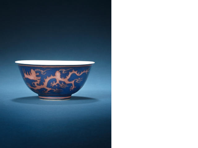 An extremely rare blue-ground and copper-red 'dragon' bowl Kangxi six-character mark and of the period