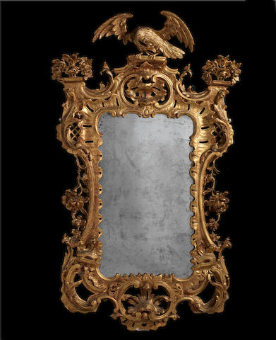 A George III Irish carved giltwood cartouche wall mirror