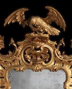 A George III Irish carved giltwood cartouche wall mirror