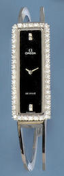Omega: A De Ville lady's white gold/diamond set bangle wristwatch