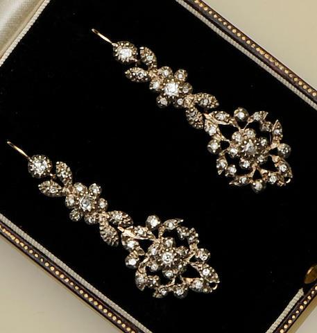 A pair of diamond set pendant earrings
