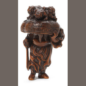 A wood netsuke of Shoki with oni 19th century