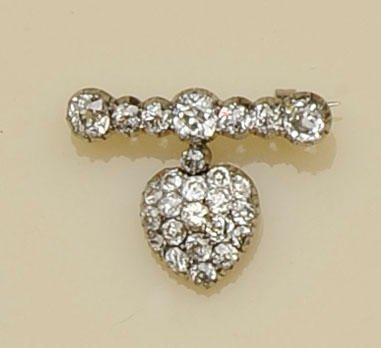A diamond heart shaped brooch