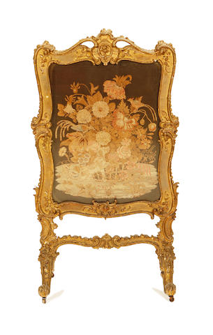 A Victorian giltwood and composition firescreen in the Rococo revival style