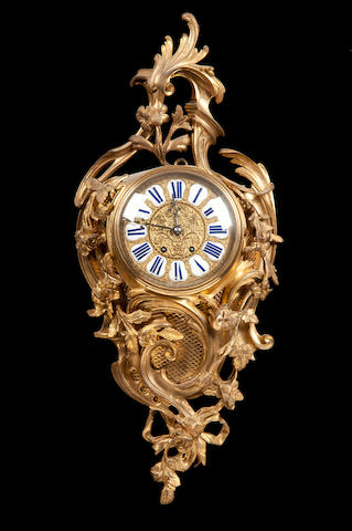 A late 19th century French gilt metal cartel clock