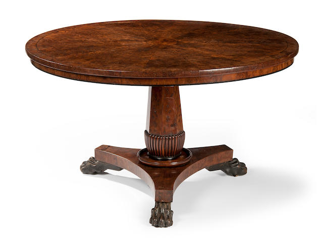 A William IV burr yew circular centre table in the manner of Gillows