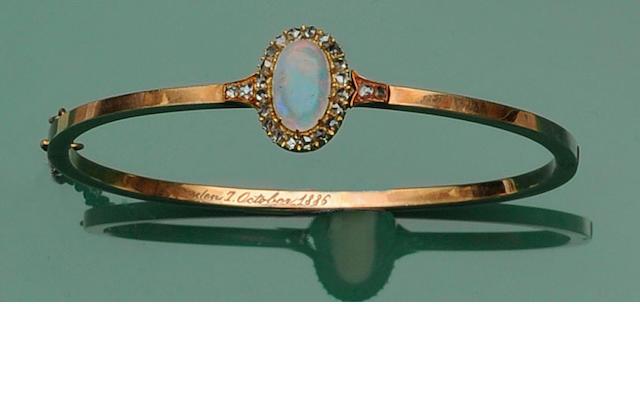 A Victorian gold opal and diamond bangle