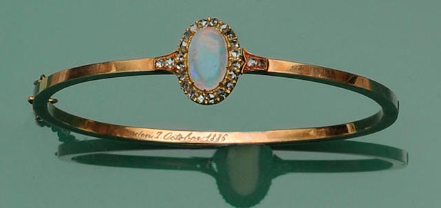 A Victorian gold opal and diamond bangle